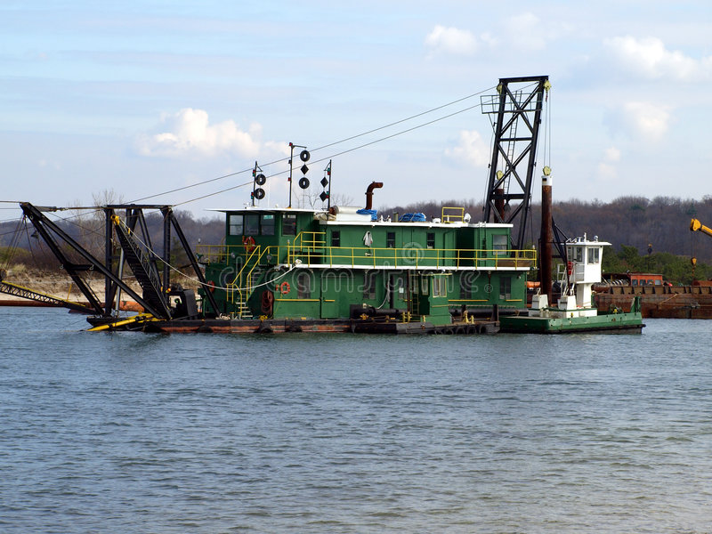 Dredge. Barge on Long Island river royalty free stock photography