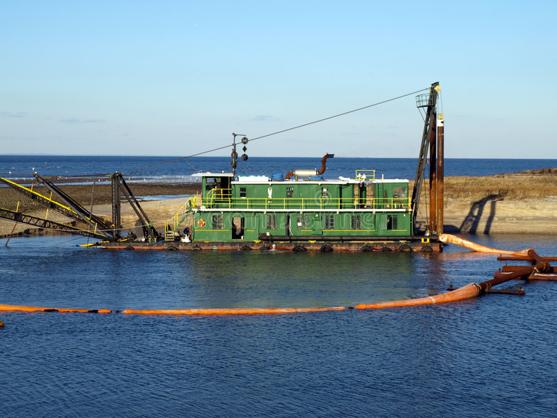 Dredge. Barge on Long Island river stock photo