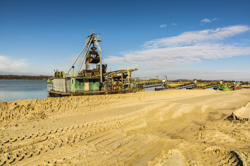Dredge for the extraction of aggregates. Dredge for the extraction of gravel pits aggregate in water stock images