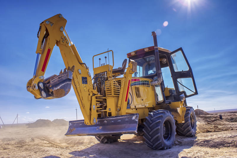 Dredge. Makes a trench for a pipeline in the desert Betpakdala royalty free stock image