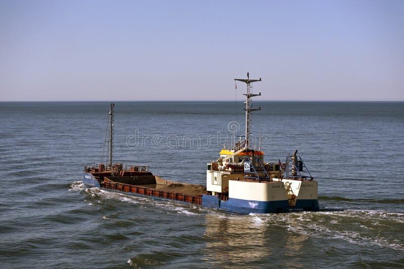 Dredger. 02.04.2013 The dredger 'Roar R' in Esbjerg, Denmark dredging the buoy channel deeper for the vessel traffic stock photography