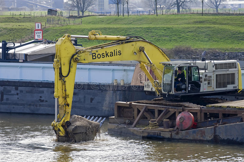 Dredging in inland waterway, Netherlands royalty free stock images