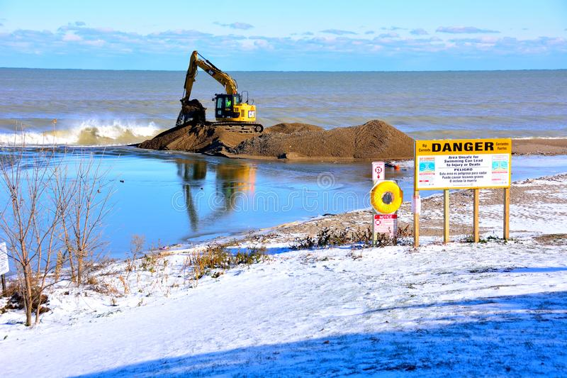 Dredging Pike River at Lake Michigan in November. Kenosha, Wisconsin / USA - November 12, 2019: Dredging underway to clear area at end of Pike River where it royalty free stock photo