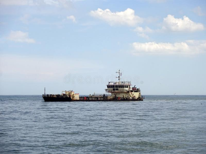 Dredging the Sand Bar off Ocean City Maryland stock image