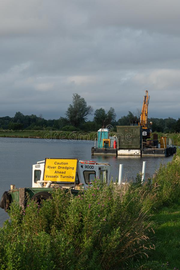 Dredging vessels along the River Waveney in Beccles, Suffolk, England stock images