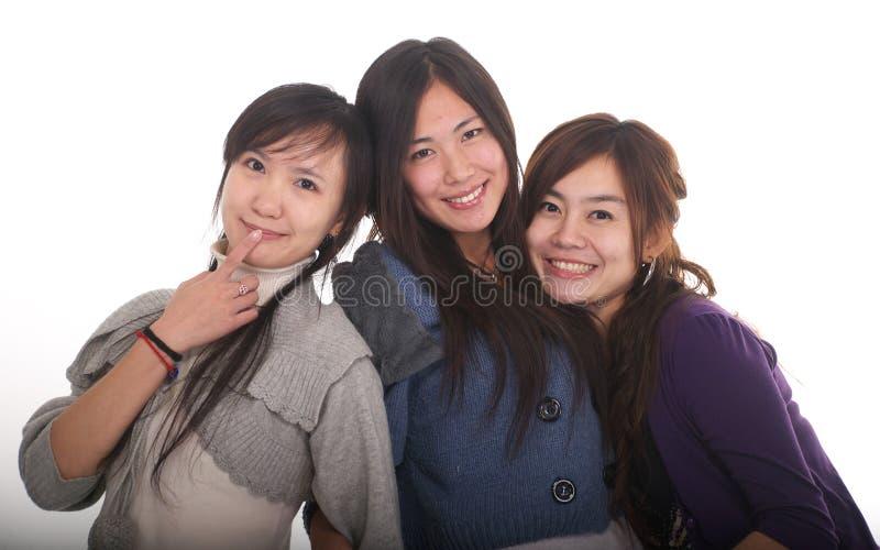 Drei asiatische Mädchen stockfotos