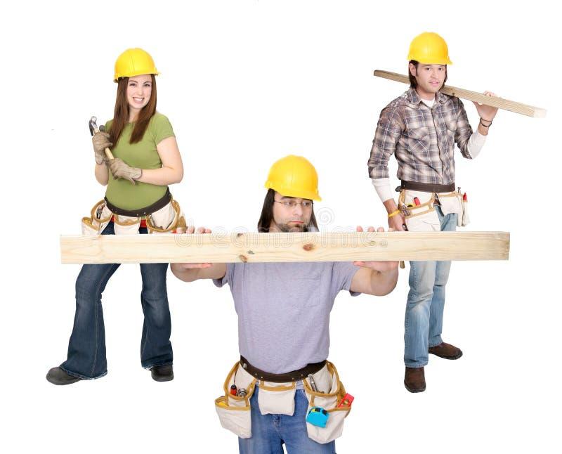Drei Aufbauleute stockbilder