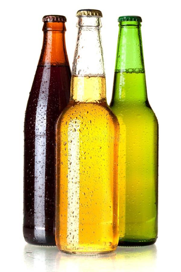 Drei Bierflaschen stockfotos