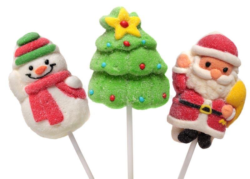 Drei Bonbons des neuen Jahres Weihnachtsbaum, Santa Claus und Schneemann Getrennt auf einem weißen Hintergrund stockfoto