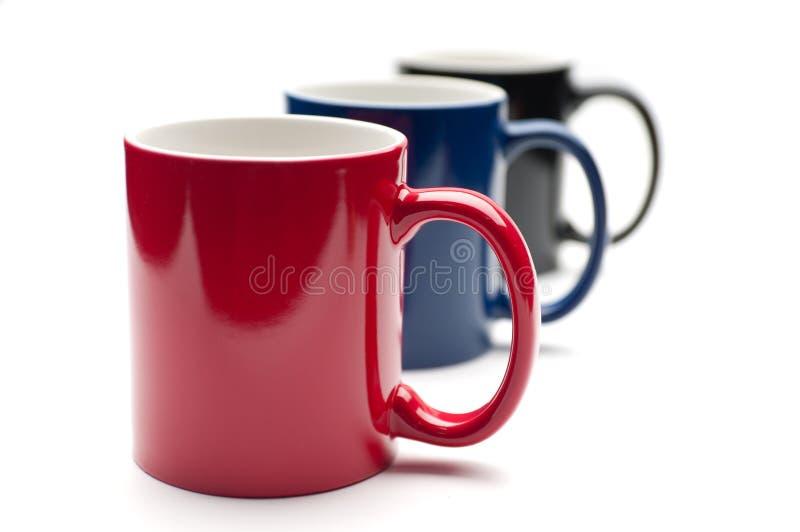 Drei bunte Cup stockfotos