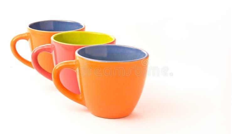 Drei bunte Kaffeetassen stockfotografie