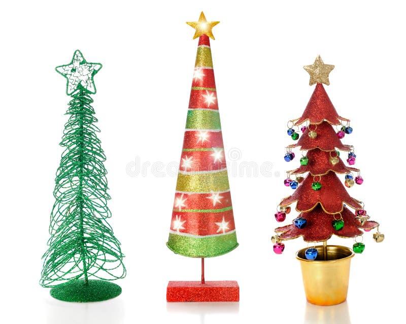 Drei einzigartige Weihnachtsbäume lizenzfreie stockfotos