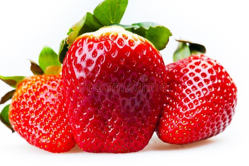 Drei Erdbeeren lizenzfreie stockfotografie