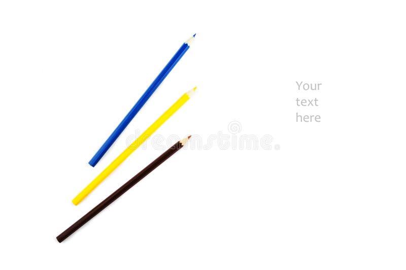 Drei farbige Bleistifte auf einem weißen Hintergrund stock abbildung