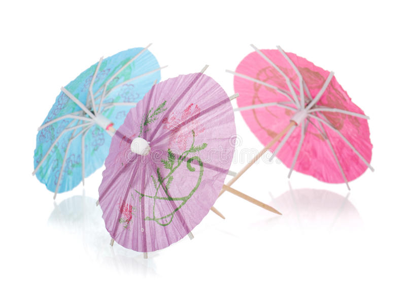 Drei farbige Cocktailregenschirme stockfoto