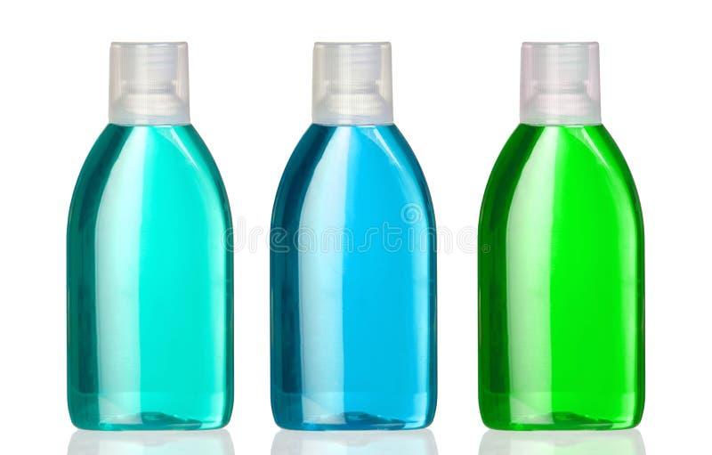 Drei Flaschen Mundwasser stockbilder