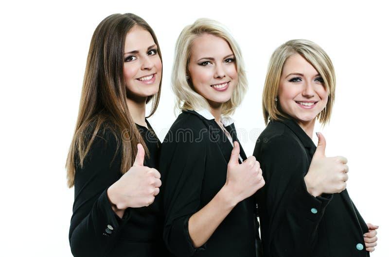 Drei Frauen, die Daumen aufgeben lizenzfreies stockbild