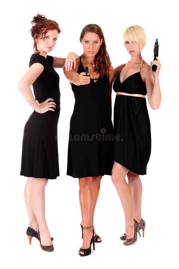Drei Frauen schwärzen Feuerwaffen stockbild