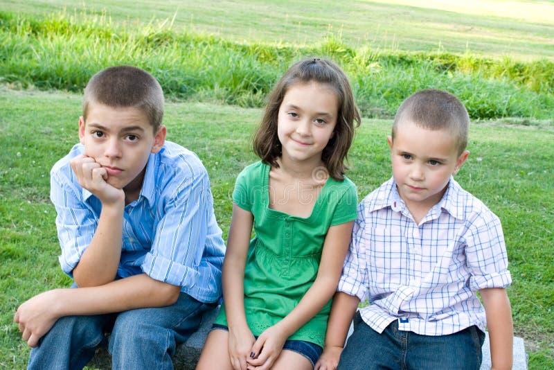 Drei gebohrte Kinder lizenzfreies stockfoto