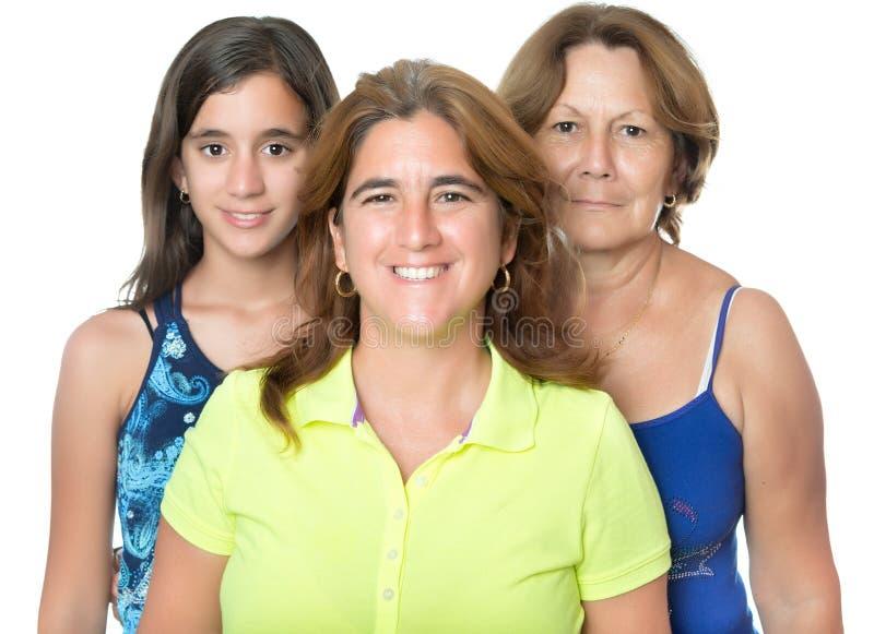 Drei Generationen in einer Familie von hispanischen Frauen lizenzfreie stockfotos