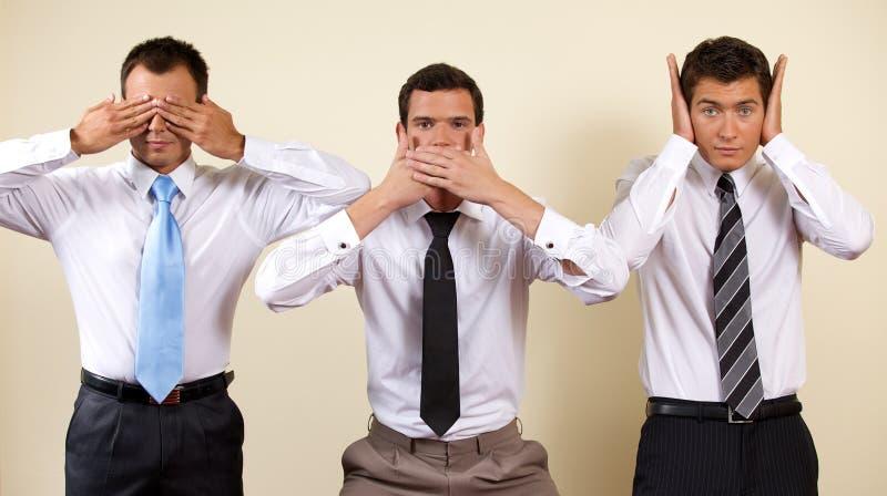 Drei Geschäftsmannbedeckungsaugen, -mund und -ohren lizenzfreies stockbild