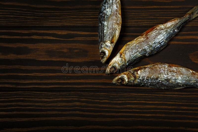 Drei getrocknete Fische lizenzfreie stockbilder