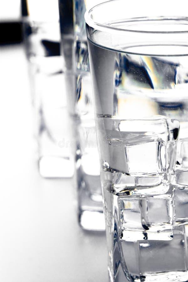 Drei Gläser mit Wasser stockbild