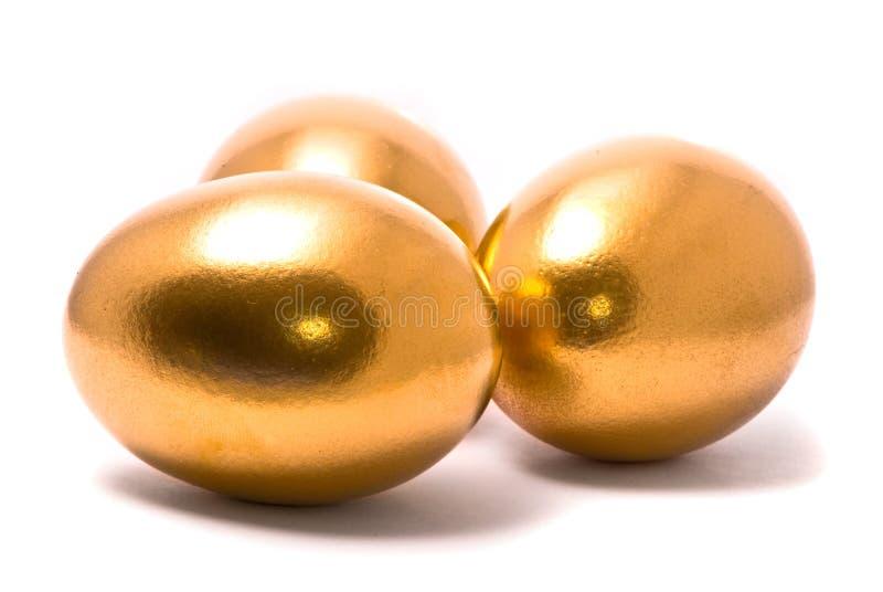 Drei goldene Eier stockfotografie