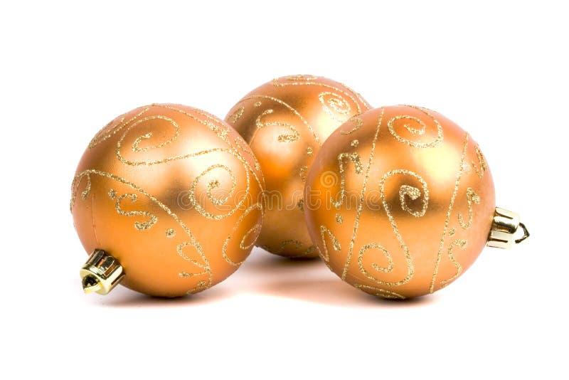 Drei goldene Weihnachtskugeln lizenzfreies stockbild