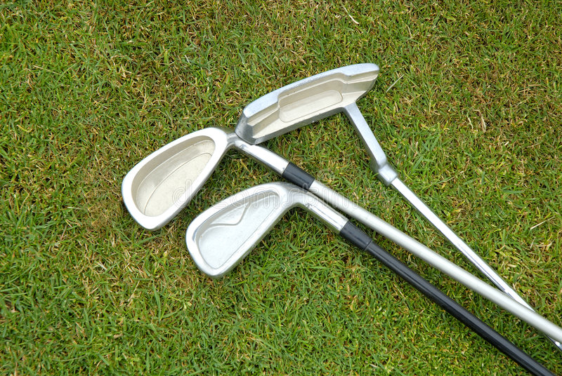 Drei Golfclubs stockbild