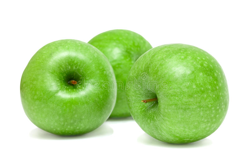 Drei grüne Äpfel stockbilder