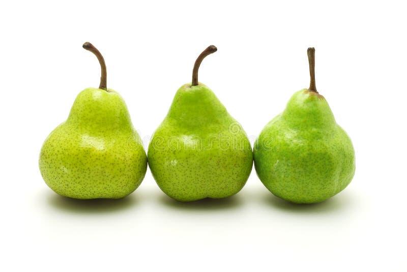 Drei grüne Birnen stockbild