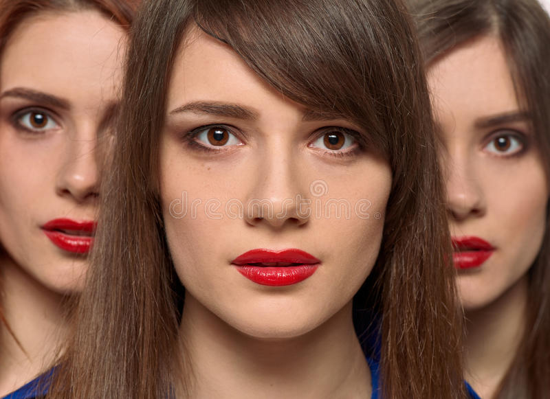 Drei hübsche Frauengesichter Dreiergruppenschwestern lizenzfreies stockbild