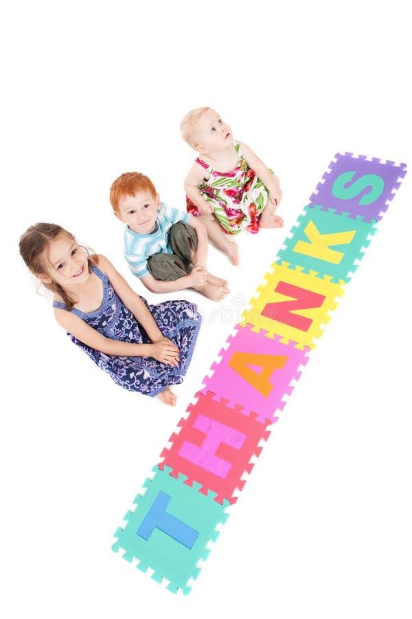 Drei Kinder, die Dank sagen lizenzfreie stockbilder