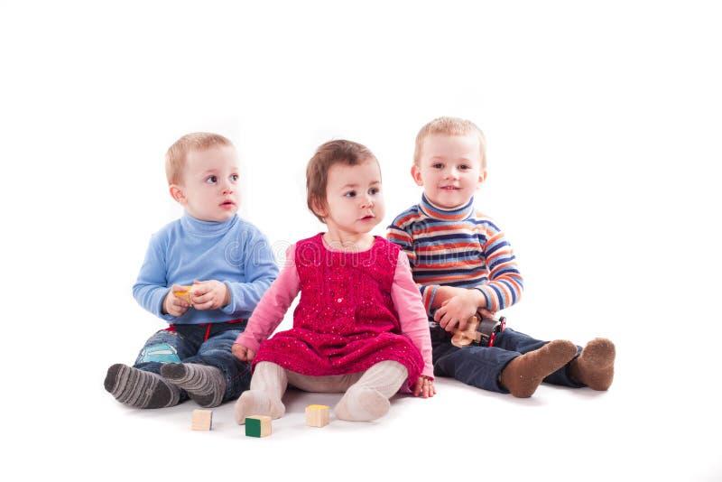Drei Kinderspiel lizenzfreies stockbild