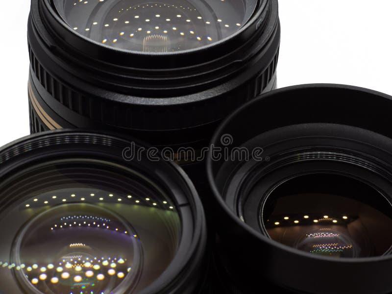 Drei Linsen von den Spiegelreflexkameras stockbilder