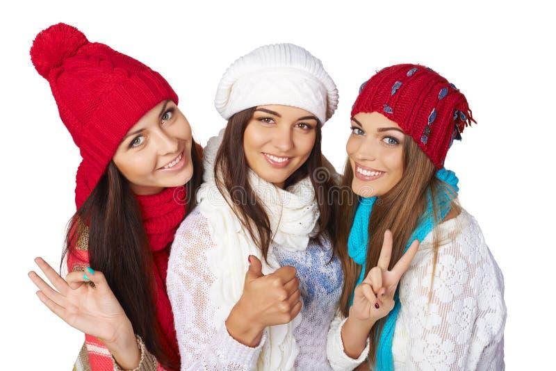 Drei Mädchen, die anerkennend Gesten zeigen lizenzfreie stockfotografie