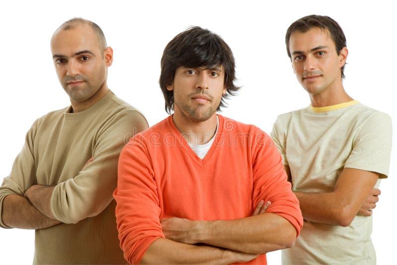 Drei Männer stockbild