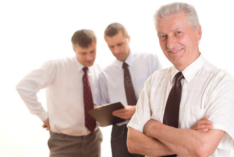 Drei Männer auf einem Weiß lizenzfreie stockbilder