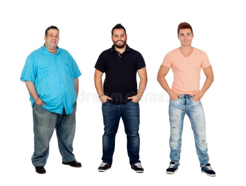 Drei Männer mit unterschiedlichem Teint stockfotos