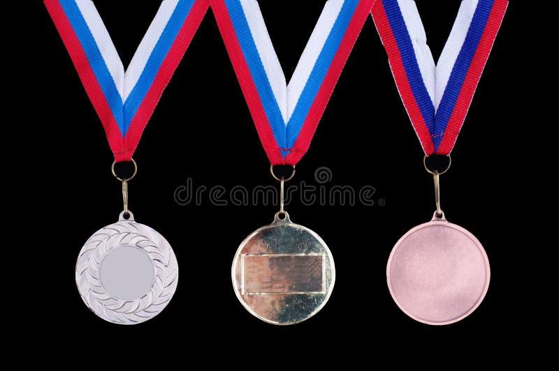 Drei Medaillen, Gold, Silber und Bronze stockbild