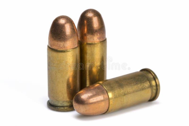 Drei Pistolen-Kugeln stockbild