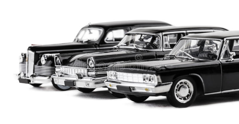 Drei Retro- Spielzeugautos lizenzfreie stockbilder