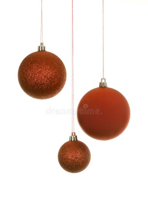 Drei rote Weihnachtskugeln lizenzfreies stockfoto
