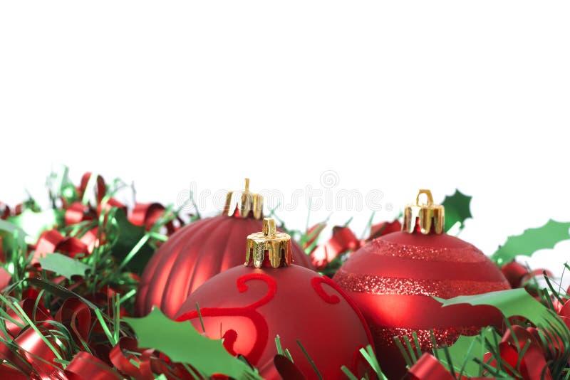 Drei roter Weihnachtsflitter auf Filterstreifen lizenzfreie stockfotos