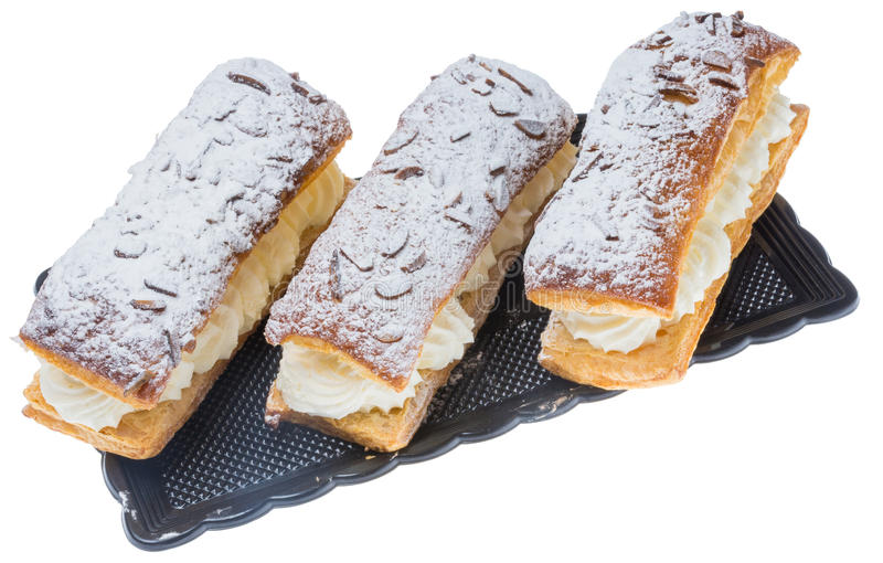 Drei Sahnekuchen auf einem wenigen Versuch lizenzfreie stockbilder