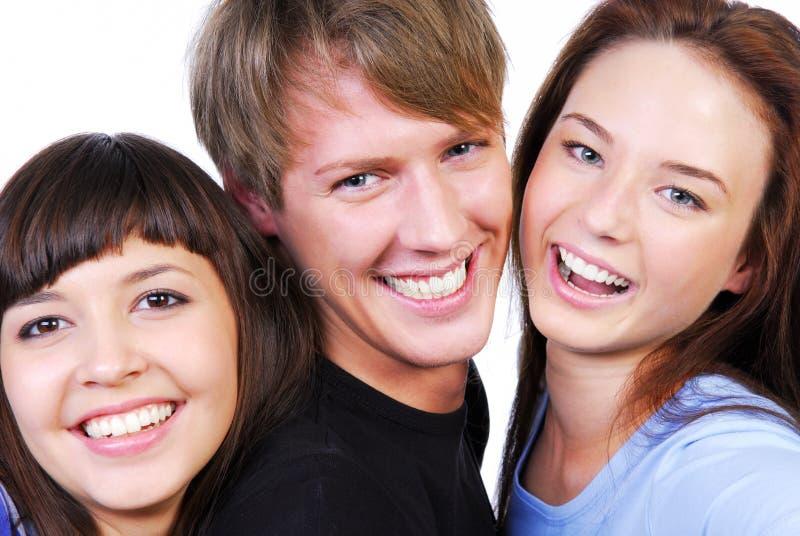 Drei schöne Jugendliche stockbild