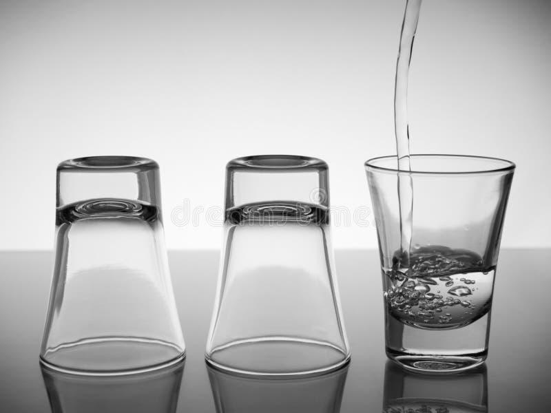 Drei Schüsse Wodka lizenzfreie stockbilder