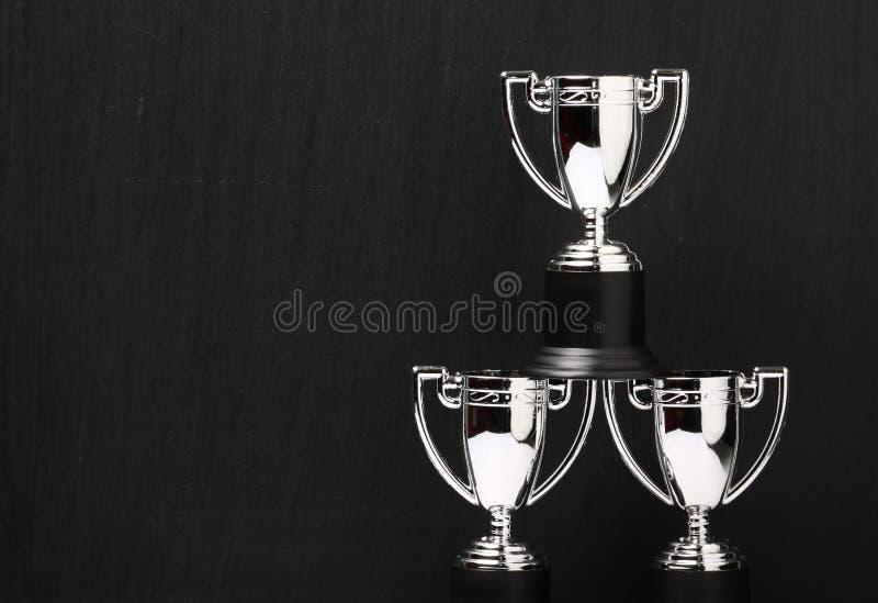 Drei silberne Trophäen lizenzfreies stockbild