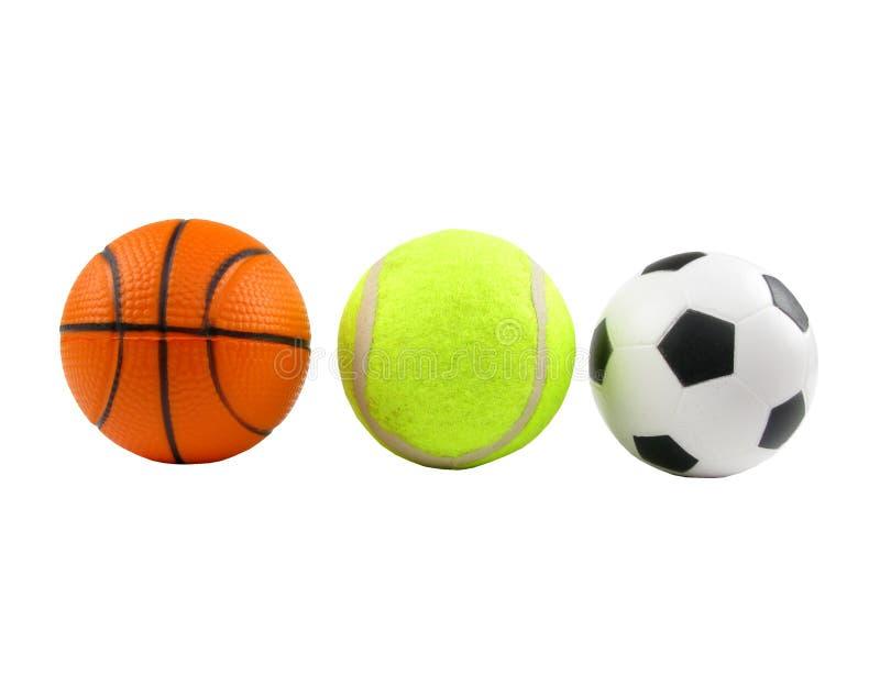Drei Sportkugeln über Weiß lizenzfreie stockfotos